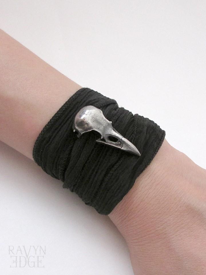 Medium sterling silver raven skull on silk wrap bracelet