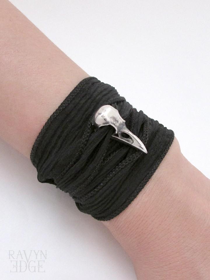 Small sterling silver raven skull and silk wrap bracelet
