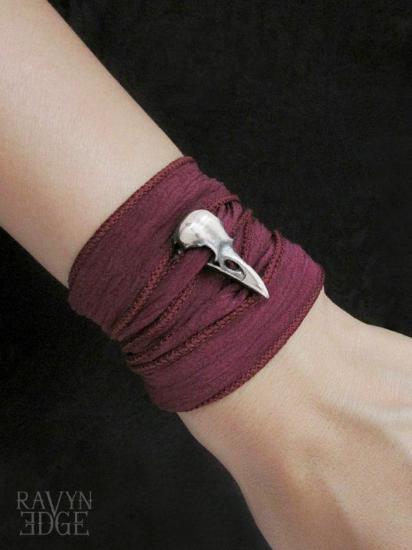 Wine red silk wrap bracelet with silver raven skull