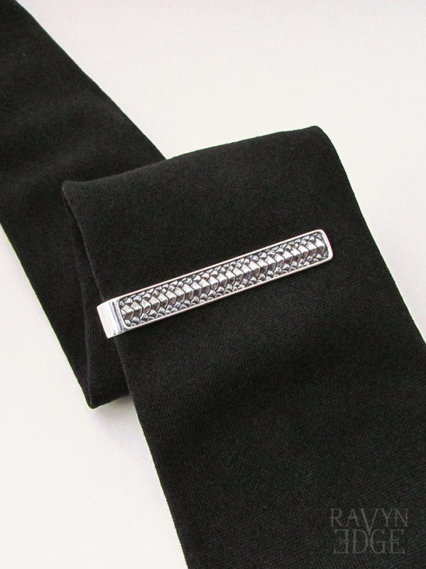 Sterling silver dragon scale tie bar on a black tie