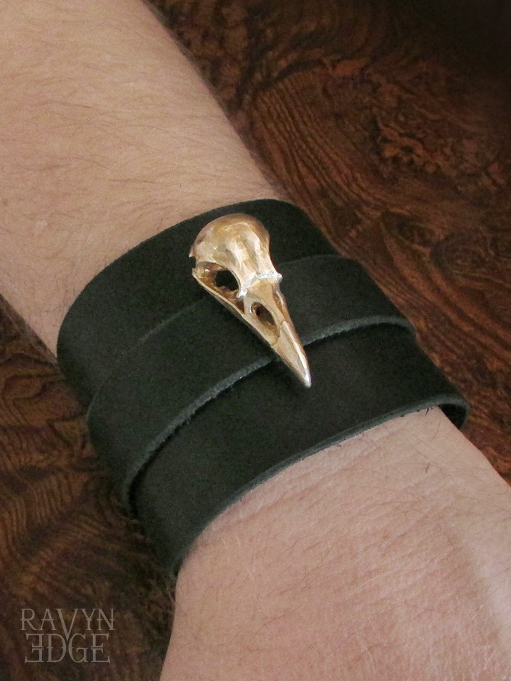 Brass raven skull on a black leather wrist cuff