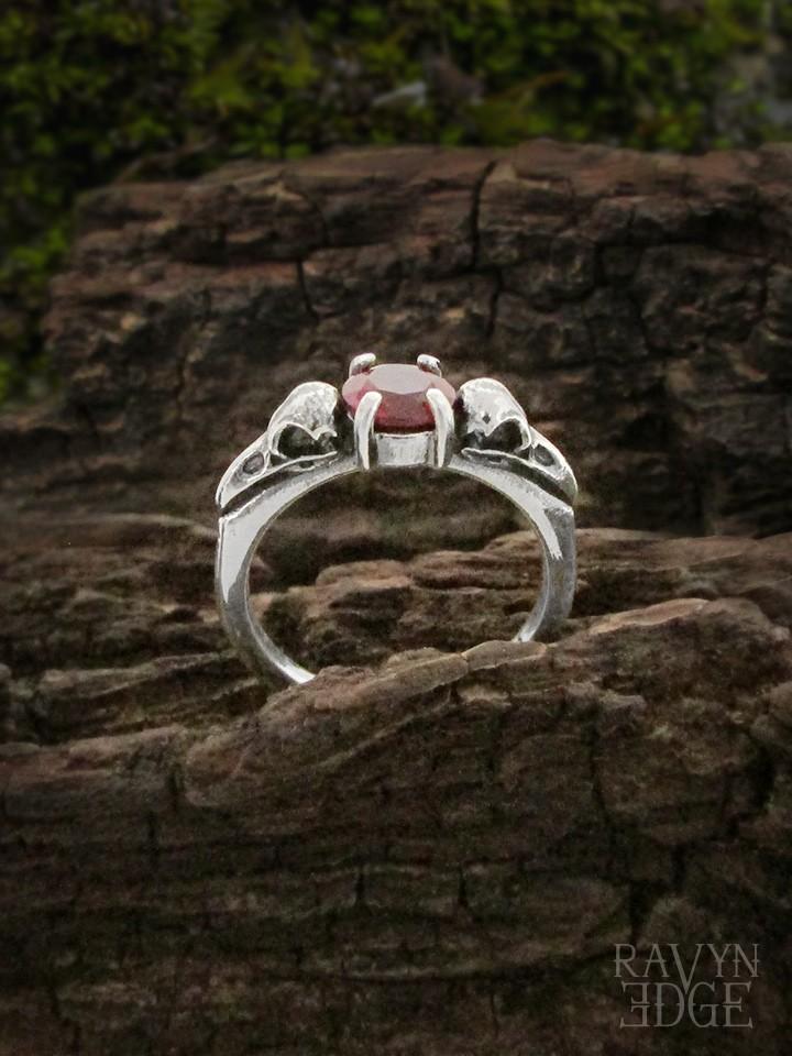 Raven skull promise ring with garnet birthstone